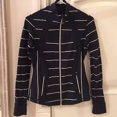 Lululemon 'Define' jacket Lululemon 'Define' jacket in black and white stripe. Size 6, but runs small. Luon material, which is medium weight stretch. Silver tone zipper with Lululemon logo pull. Zips all the way up to a mock neck height. Sleeves have thumb holes and optional cuffs to cover hands. Back vent (see second pic). Zip pockets. Slightly longer in back than in front. Lightly worn and in excellent condition. lululemon athletica Jackets & Coats