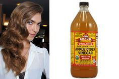 "Apple Cider Vinegar is an inexpensive way to boost shine and remove product build-up.  An apple cider vinegar rinse removes residue and restores hair's pH balance back to its natural acidic state. It also closes the hair's cuticle so that hair lies flat, making it glossy, healthy and more manageable."" And if all that wasn't enough, it's a great way to add subtle highlights to brunette hair, and remove excess sebum from the scalp."