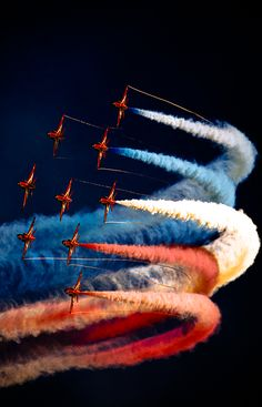 Red Arrows creating quite a display against a inky blue dark sky. Beautiful colours and smoke detail