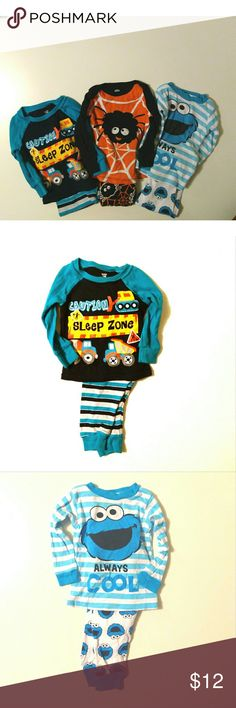 3 Pajama bundle for boys. Size 12mo. 3 sets of PJs for boys.  One of them is blue and white with Cookie Monster ??.  The next one is turquoise and black with construction vehicles ??.  The last one is black and orange and it has a Halloween spider ??.  Excellent condition and they were always washed and dried in delicate setting and used Dreft detergent. Pet free and smoke free home. Pajamas Pajama Sets
