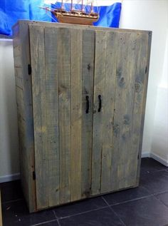 these DIY pallet storage units for a perfect fit to your desired area! This rustic DIY pallet file organizer has been made of old pallet wood lying on a Diy Dvd Storage, Pallet Storage, Pallet Shelves, Storage Ideas, Wooden Pallet Projects, Pallet Crafts, Diy Pallet Furniture, Pallet Ideas, Recycled Pallets