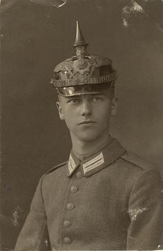 Guard infantryman with a private purchase helmet.