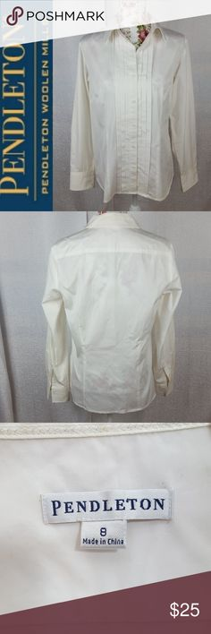 PENDLETON White Classic Button Down Blouse This Pendleton blouse is beautifully made with Darden at the bus and pleats down the front. Ribbon details at cuffs. EUC.   Length: 24 inches from shoulder to hem  Bust: 19 inches laying flat Pendleton Tops Button Down Shirts