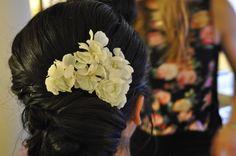 Flower pins on dark hair bridal updo. Joanna, April 16, 2016 - Makeup and Hair by Alina Karaman
