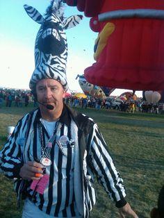 Crowd controller zebra man