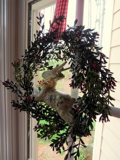 Made wreath from garland, added paper mache deer (sponge painted) hung with checked ribbon from window latch