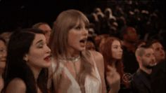 This endearing attempt to connect with the chick next to her, who's clearly not as invested in the performance. | The 25 Best Taylor Swift Audience-Dancing Moments Of All Time