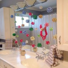 Elf decorates kids' bathroom mirror.