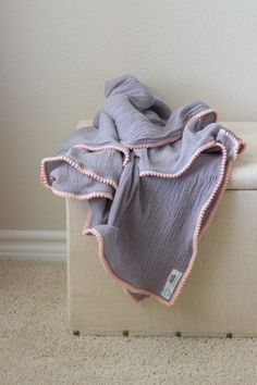 Hey, I found this really awesome Etsy listing at https://www.etsy.com/listing/242275287/pom-pom-swaddle-light-grey-with-peach