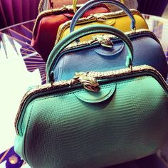 Bulgari framed top handle bags.