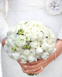 A bouquet of white ranunculus is perfect for a snowy wedding