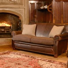Stornaway sofa by Tetrad. Leather and Harris Tweed, my favourite combination.
