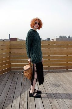 """4 New York Bloggers, 1 Full Month Of Looks #refinery29  http://www.refinery29.com/april-outfit-ideas#slide-20  Saturday""""This dress is great — it's subtly sexy with the ties at the sides. An oversized men's sweater over it subdues the peek of skin a little.""""What She's Wearing: Cheap Monday dress, American Apparel sweater, Joy Gryson bag, and Vagabond shoes."""