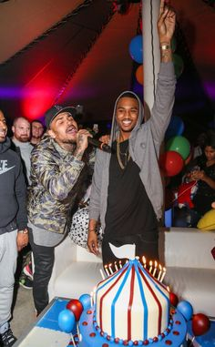 Happy birthday to you. Chris Brown serenades Trey Songz with a birthday song at the latter's 30th birthday carnival extravaganza on Nov. 22 in Agoura Hills, Calif.