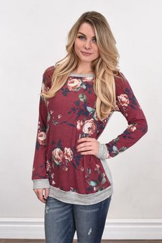 An adorable top with floral front and a solid grey back! True to size. Model is 5'5'' a size 1 wearing a small. Material: 85% polyester, 10% Rayon, 5% Spandex Product Sizing Chart Size Bust Hip Length