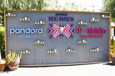 Pandora's Indio Invasion: At Pandora's fourth annual Indio Invasion, a three-dimensional press wall included graphic logos and shelving bearing desert-appropriate succulents.