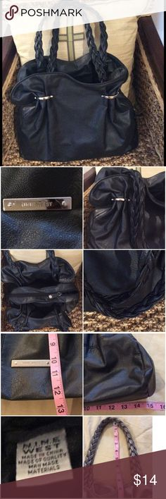 Nine West Black Handbag Good used condition. No rips. 2 big side pockets, 1 big middle zip pocket. Nine West Bags Shoulder Bags