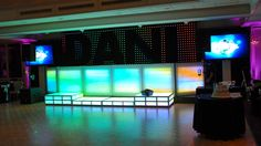 16ft LED DJ Frontboard / LED Multi-Tiered Stage / 5ftx20ft LED Curtain behind DJ Frontboard - create scrolling text / LED TV's on either side .. Awesome Set