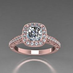 Rosegold diamond halo  charles and colvard cushion forever one