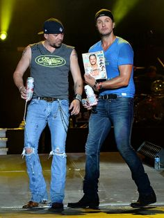 Country Cam: Jason Aldean joins Luke Bryan and is shown a copy of People Country Sexiest man alive Luke Bryan issue, during the first annual Florida Country Superfest at EverBank Field in Jacksonville, Florida.  Read more: http://www.wpoc.com/photos/main/country-cam-82079/#/1/22736268#ixzz34usWbCgj