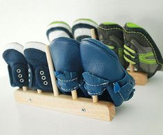Wooden plate divider racks are perfect for keeping itty-bitty shoes organized in drawers and on closet shelves.