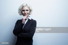 Stock-Foto : Studio portrait of businesswoman with hand on chin