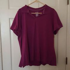 St Johns Bay short sleeve Polo top This burgundy color top is a cotton knit with ribbed sleeve and side slits St. John's Bay Tops Tees - Short Sleeve