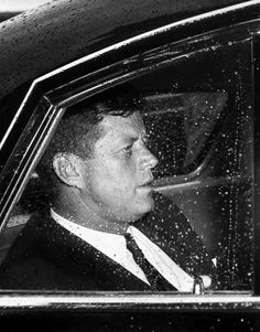 """1961. 21 Juin. By Abbie ROWE. AR6659-J . President John F. Kennedy seated in a car en route to a cruise aboard the """"Honey Fitz"""" with Prime Minister of Japan Hayato Ikeda. Hains Point, Potomac River, Washington, D.C."""