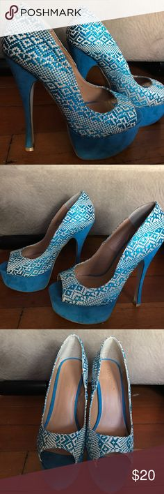 Shoedazzle Kharay peep toe pump platform blue heel Kharay, a peep-toe pump inspired by Aztec and Latin style, is sure to incite ardent admirers wherever you go.  Intricate basketweaving adds a handcrafted touch. ShoeDazzle Shoes Heels