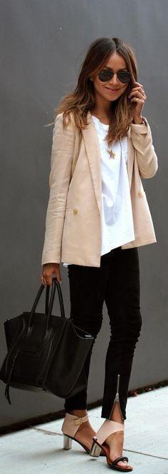 Nude Blazer + oversized white t-shirt + golden necklace + black skinnies + black handbag + nude and silver sandals