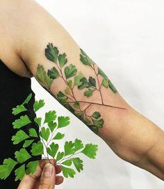 Love! Adiantum (also known as maidenhair fern) tattoo on the upper arm. Tattoo Artist: Rit Kit