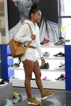 Karrueche out wearing Nike Huaraches and MCM backpack. Cute sneaker outfit for women.