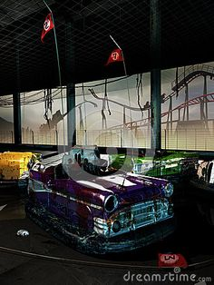 Bumper cars abandoned in their place. At the background, we see a damaged and abandoned roller coaster. Useful image to illustrate the reduction in attendance  of amusement  parks in period of crisis.