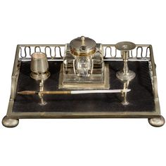 "Silvered Brass Inkwell Stand with Gallery, Ebonized Wood and Mother of Pearl Quill Holder, England 19th century. Height 4"" Width 9"" Depth 8.5"""