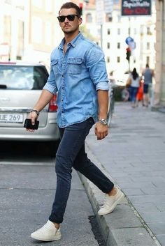 Simple and effective combo denim shirt rolled up sleeves blue chinos and white sneakers with sunglasses and watch #summerstyle #summeroutfits #denimshirt #menswear #streetstyle #streetwear #mensfashion #menstyle #chinos #whitesneakers