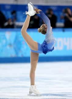 Lovely spacing and proportions make this a fabulous artistic shot. Gracie Gold - Free Skate - Sochi 2014.