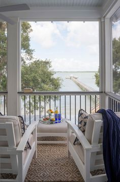 The view from the porch of the deep water dock. Mondavi Home Collection, Trex furniture we love on our waterfront porch.