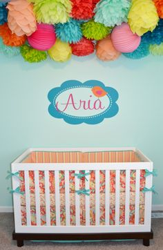 These tissue poufs over the crib make for a fun pop of color and personality in the nursery!