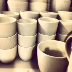 A still of unfired stoneware espresso cups.