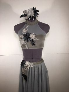 """Simple elegance in this custom grey contemporary costume. Features long skirt, open over right leg, and two-tone appliques in silver and black. For Abby - """"Stone Cold"""""""