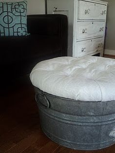 Super easy ottoman! : It is made from a galvanized tub, round piece of wood, stuffing, and fabric! Perfect for an outside porch/ or a table on the front porch
