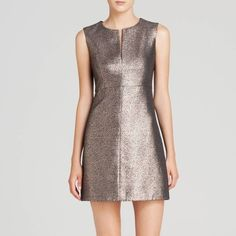 DVF Diane Von Furstenberg Yvette Metallic Dress Iconic Diane von Furstenberg dress with metallic front and solid knit back. Sold out everywhere. Size 6. Brand New with original tags. A fantastic day to evening dress!  50% off Retail, Amazing price for a SOLD OUT style! Round neckline with slit. Sleeveless; wide shoulder coverage. Seamed at high waist. Slim, fitted silhouette. Back zip. Acrylic/polyester/metallic/nylon. Imported. Diane von Furstenberg Dresses