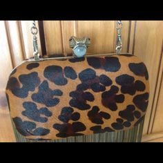 """House of Harlow 1960 Clutch House of Harlow 1960 Leopard Fringed Clutch.  Brand new with all packaging.  There is a small """"ding"""" on the lower part of clutch (see pics).  Price reflects this. House of Harlow 1960 Bags Clutches & Wristlets"""