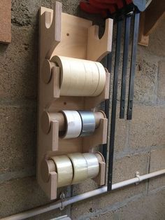 Bit of an on-a-whim workshop project, a dispenser/holder for the tape. The holders pop out to remove/replace the rolls or hold it well enough that I should be able tear off a strip without pulling the... #WoodworkingIdeas