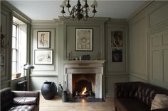 Lounge with walls in French Gray Estate Eggshell, trim in London Stone Estate Emulsion and ceiling in Blackened Estate Emulsion.