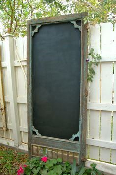 vintage screen door - add exterior grade plywood panel painted with exterior grade chalkboard paint