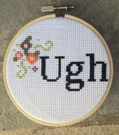 4-inch hoop completed cross stitch    Ugh in black with a flower border    Cross stitch made to order. Takes one week plus shipping time.