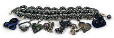druga baza bransoletki z czarnymi perłami http://aukcje.wosp.org.pl/bransoletka-z-perlami-8-charmsow-bizuteryjki-i1226939