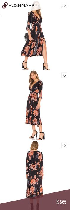 """NWT Free People Miranda Midi Dress Brand new with tags - sadly this beauty is too small for me! Make a flirtatious entrance in a breezy midi-length dress enlivened with vibrant floral embroidery and finished with a pocket at the bust and a split hemline. 49"""" length shoulder to hem, 17"""" across bust, 13.5"""" across waist  Front button closure. V-neck. Long sleeves with single-button cuffs. 100% rayon, color is black combo. Free People Dresses Midi"""