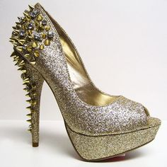 Strut it fiercely and kick it gold school in these glittering platform stilettos with impossible to ignore sharp stud and rhinestone detailed heels.